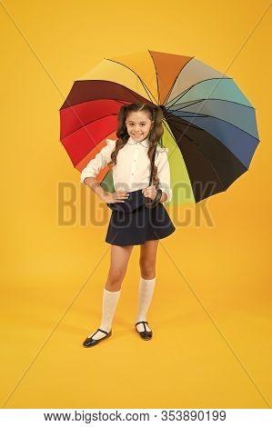 Stay Dry. Fancy Schoolgirl. Girl With Umbrella. Rainy Day. Happy Childhood. Rainbow Style. Kid Happy