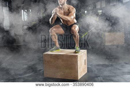 Bodybuilder Man, Does The Cardio Exercise, Jumping On A Wooden Box In The Gym. Sport Concept, Fat Bu