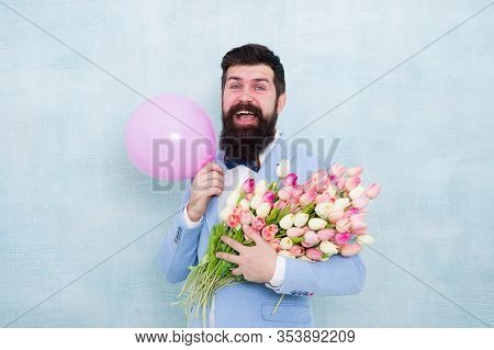 Shower Love Upon Her With Flowers. Happy Hipster Hold Tulips And Balloon. Love Gift. Romantic Bouque