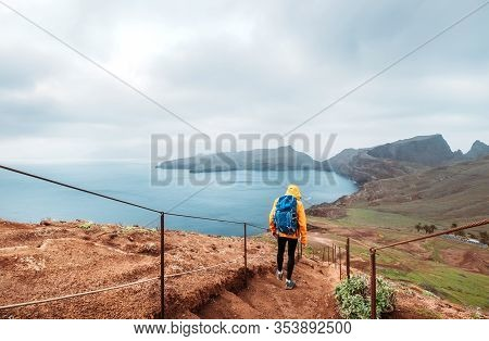 Young Male Backpacker Hiking By Footpath On Sao Lourenco Headland With Atlantic Ocean Bay View In Th