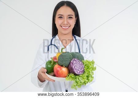 Doctor Or Nutritionist Holding Fresh Fruit (orange, Red And Green Apples) And Smile In Clinic. Healt