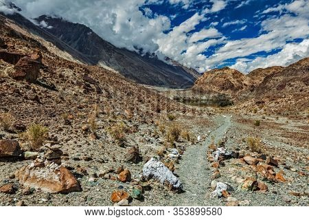 Foot path to sacred Buddhist lake Lohat Tso in Himalayas. Nubra valley, Ladakh, India