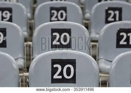 Chairs With Marking Number 20 On The Seat.