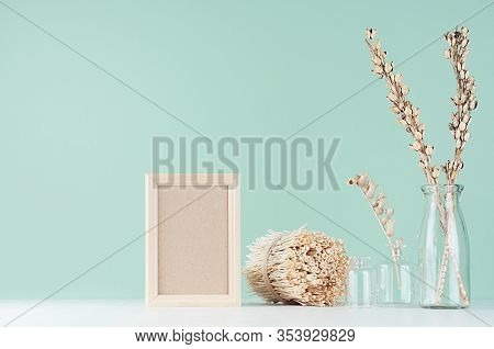 Home Decor In Eco Style - Blank Photo Frame, Dried Plants, Twigs In Glass Bottle, Twigs Bunch In Gre