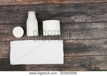 Body And Skin Care Products In White Packaging On A Wood Background. Personal Hygiene Products. View