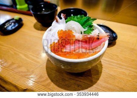 Sashimi Served Fresh Rice Bowl  On Top Salmon,tuna, Salmon Eggs , Slice Squid And Small Shrimp, Clos