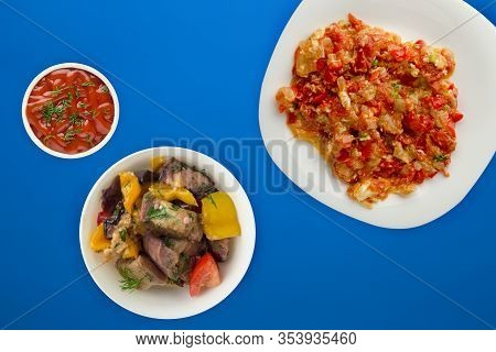 Stewed Tomatoes With Onions In A White Plate On A Blue Background. Stewed Tomatoes With Onion Top Vi
