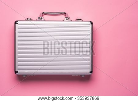 Contemporary Aluminum Briefcase On Pink Background. Flat Lay Concept.