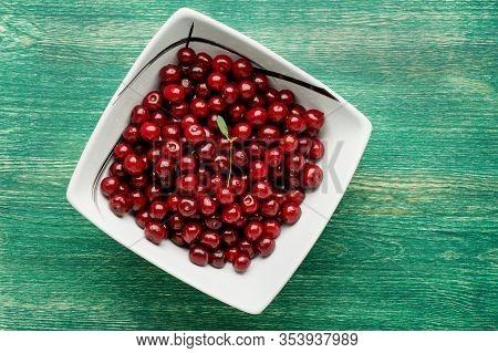 Fresh Cherries Berries In Bowl On Dark Rustic Wooden Background