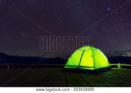 Glowing Green Camping Tent On Bamboo Terrace Under The Night Sky Full Of Stars And The Milky Way, Ba