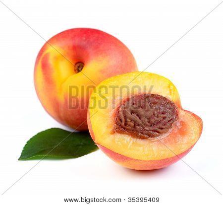 Fresh Peach Fruits With Green Leaf