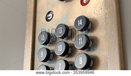 An Old Retro Elevator Control Panel With Fourteen Floors Made Of Brass And Wood With Analog Buttons