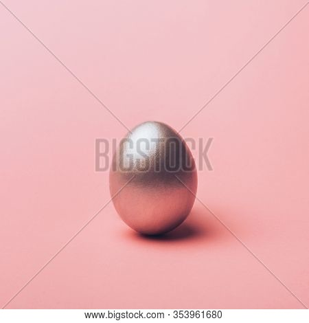 Silver Metal Easter Egg On A Pink Background, Decoration, Holiday Background Concept. Pastel Tone, C