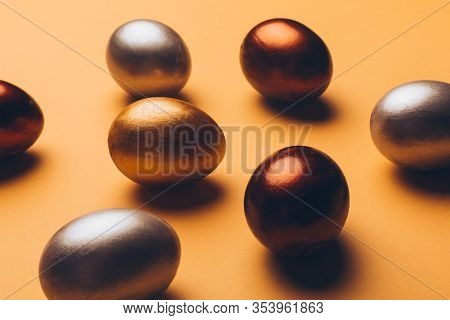 Bronze, Silver And Gold Easter Eggs On A Yellow Background., Decoration, Holiday Background Concept.
