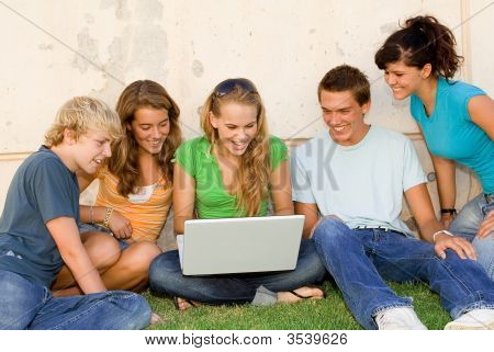 group of students studying outdoors with laptop happ smiling youth poster