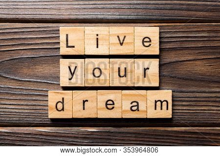 Live Your Dream Word Written On Wood Block. Live Your Dream Text On Wooden Table For Your Desing, Co