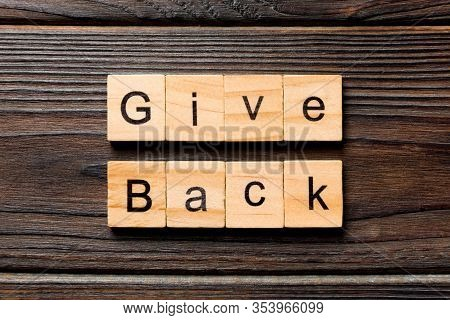Give Back Word Written On Wood Block. Give Back Text On Wooden Table For Your Desing, Top View Conce