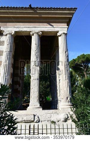 Temple Of Portunus Or Tempio Di Portuno. Ancient Classical Greek Style Roman Temple. Rome, Italy.