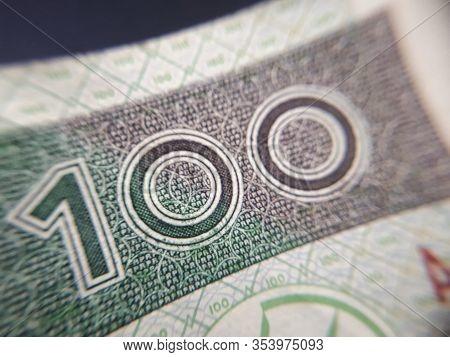 Macro (pln) Polish 100 Zloty Banknotes Background. One Hundred Zloty Banknotes. Close-up Photo. Naro