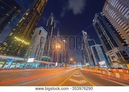 Car Light Trails On Road Or Street In Dubai Downtown Skyline And Highway, United Arab Emirates Or Ua