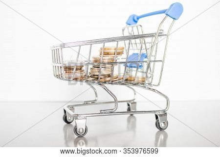 Stack Of Coins In A Grocery Cart Concept Inflation, Finance, Donation