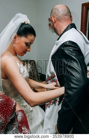 Lutsk, Volyn / Ukraine - November 14 2009: The Bride Binds A Towel To A Godfather At Home