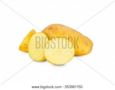 Whole And Sliced Unpeeled Fresh Potato On White Background