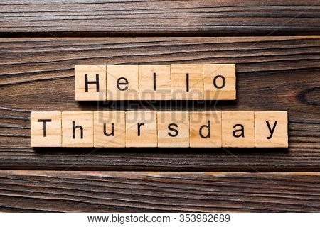 Hello Thursday Word Written On Wood Block. Hello Thursday Text On Wooden Table For Your Desing, Conc