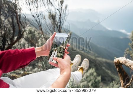 Woman Sitting Above The Precipice Highly In The Mountains With Great View On The Island, Photographi