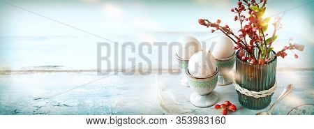 Breakfast Scene With Easter Eggs. Still Life In Vintage Style With Pastel Colored Eggs And Fresh Spr