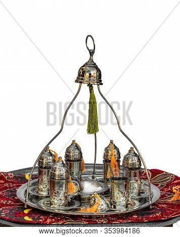 Traditional Turkish Silver Tea Set With Ornate Tea Cups And Sugar Bowl On A Tray On White Background