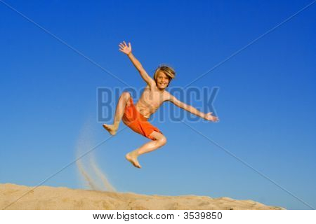 Happy Child Jumping On Vacation