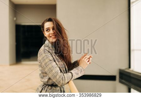 Lifestyle portrait of Real Young Happy woman with long hair