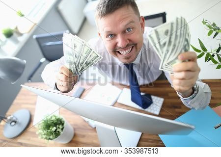 Top View Of Happy Smiling Man Holding Money Fans In Hands. Cheerful Gambler Getting Big Cash Prize A