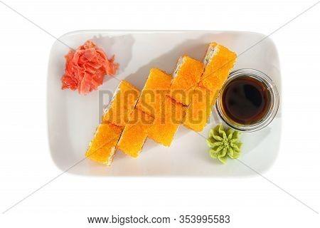 Sushi, Rolls, Uramaki California With Tobiko Caviar, Avocado, Raw Seafood, Soy Sauce, Marinated Ging