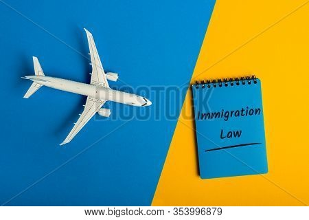 Immigration Law. Message In Notepad Near Airplane Model. Immigration And Emigration, Refugee Issues