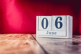 June 6th. Day 6 Of Month, Calendar On Business Office Table, Workplace With Vivid Maroon Red Backgro