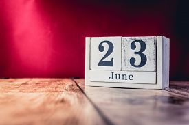 June 23rd. Day 23 Of Month, Calendar On Business Office Table, Workplace With Vivid Maroon Red Backg