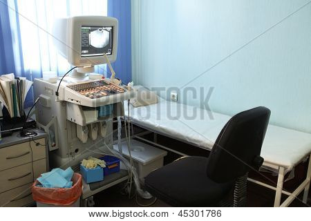 The image of an empty doctor's consulting room
