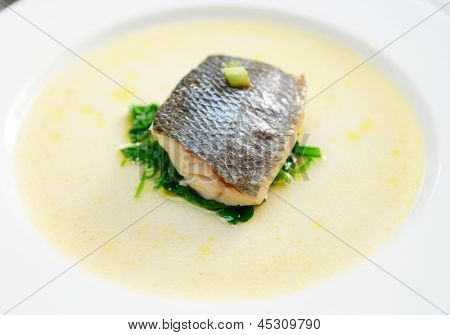 Simple cooked but tasty piece of steamed seabass fillet poster