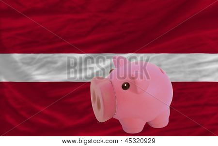 Piggy Rich Bank And  National Flag Of Latvia
