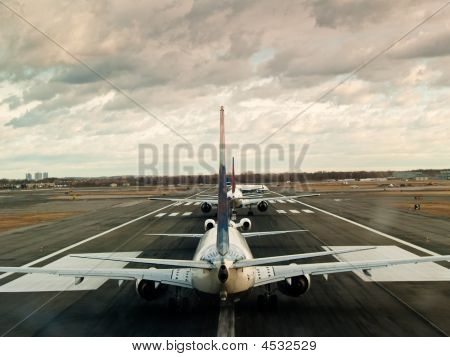 Airliners Waiting To Take Off At New York Jfk Airport.