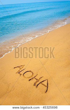 Word Aloha Written In Sandy On Tropical Beach
