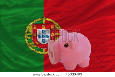 Piggy Rich Bank And  National Flag Of Portugal
