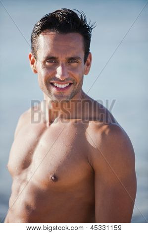 Portrait of a bare chested man smiling