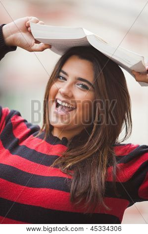 Woman overweight with book