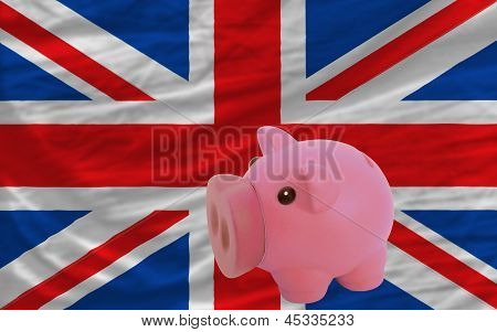 Piggy Rich Bank And  National Flag Of United Kingdom