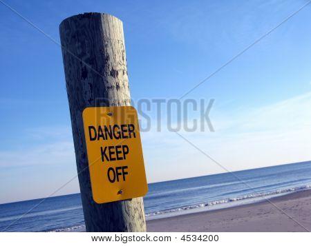 Danger Keep Off Sign On A Beach