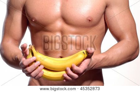 Shaped and healthy body man holding a fresh bananas,shaped abdominal,