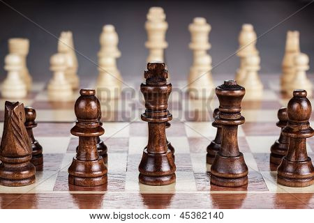 chess board with figures on the wooden table